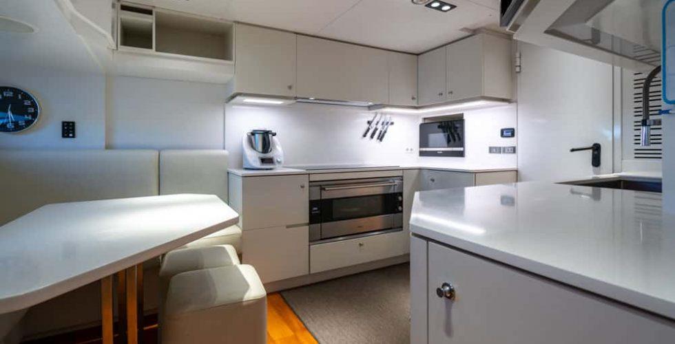 Paula-&-Biel-peri-37m-motor-yacht-interior-galley-and-dinette